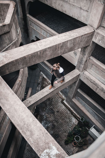 High Angle View Of Man Walking On Abandoned Building