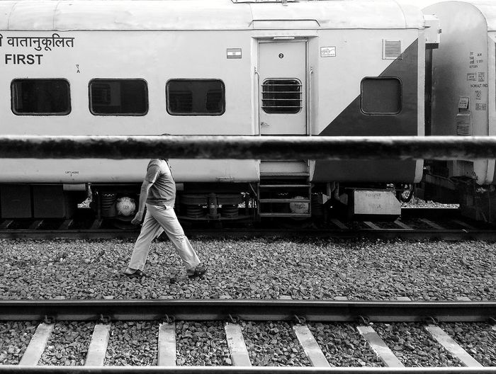 Full length rear view of man train at railroad station