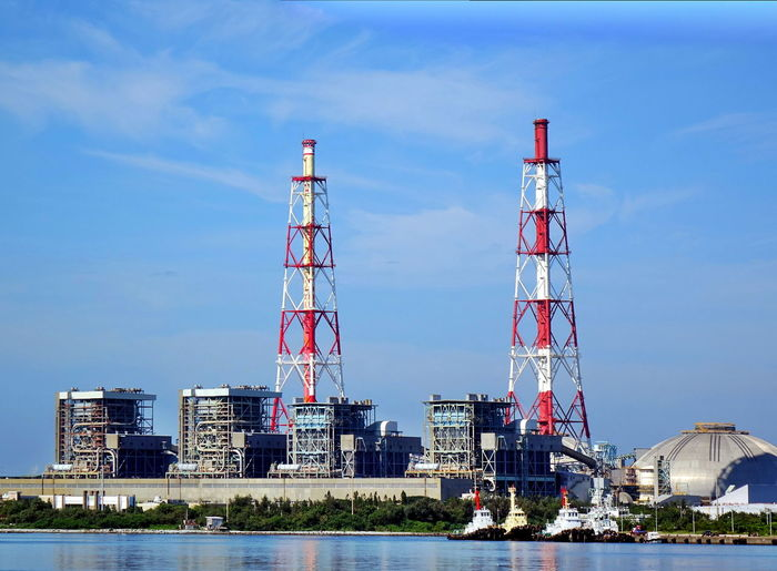 Thermal power plant with tall chimneys Chimney Power Plant Smoke Stack Blue Sky Built Structure Coal Fired Power Station Electricity Generation Energy Industry Factory Industry Ocean Power And Energy Ships Thermal Power Plant