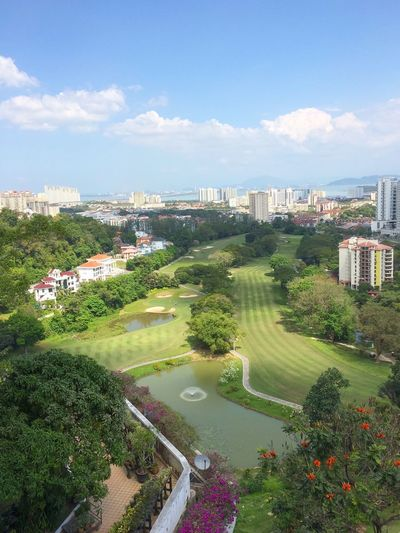 Golf Course Architecture Built Structure Building Exterior Sky City High Angle View Cityscape Tree Cloud - Sky Day No People Outdoors Water Grass Nature Residential