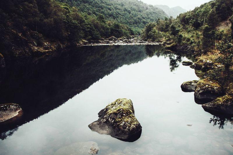Reflection of rocks in lake