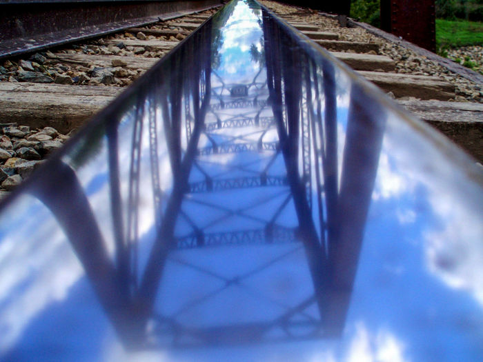 Composition Architecture Bridge Bridge - Man Made Structure Built Structure Close-up Connection Day Diminishing Perspective Metal Nature No People Outdoors Rail Transportation Railroad Track Reflection Selective Focus Steel Surface Level The Way Forward Track Transportation Summer Exploratorium Visual Creativity Focus On The Story