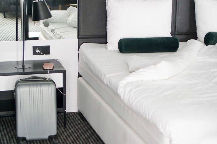 Furniture Bed Pillow Bedroom Indoors  Absence White Color Domestic Room No People Empty Relaxation Home Interior Comfortable Luxury Linen Hotel Wealth Home Showcase Interior Modern Stuffed Duvet Traveling Charging Suitcase Luggage Trolley Room Arrival Side Table Travel Destinations Summer Road Tripping Sheets