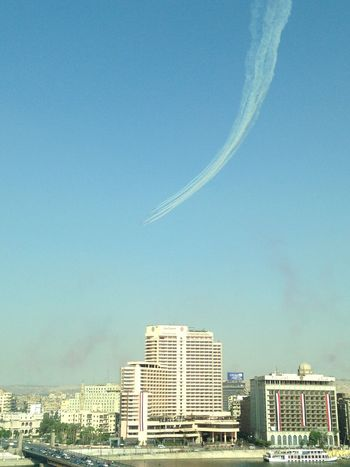Airplane Architecture Building Exterior Built Structure City Cityscape Clear Sky Day Egyptian Air Force Flying Nature No People Outdoors Sky Vapor Trail