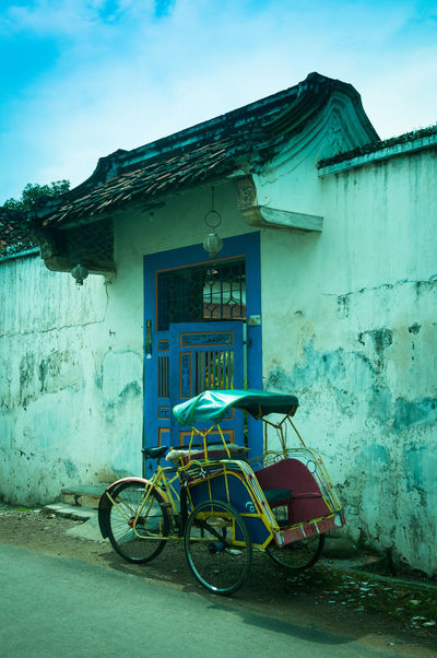 A becak parked in front of an old house in Lasem, Indonesia Architecture Becak Building Exterior Day Lasem  No People Outdoors Traditional Transportation