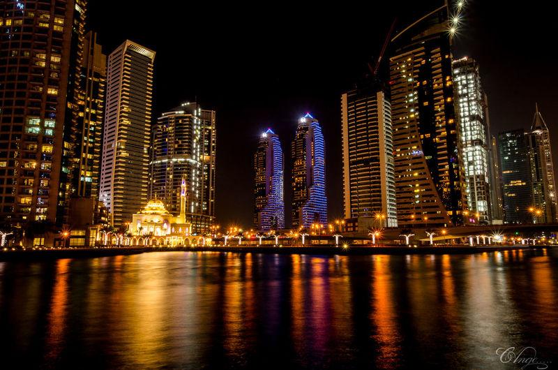 Dubai Building Exterior Illuminated Night Reflections In The Water Skynightphotography Tower Urban Skyline Voyage