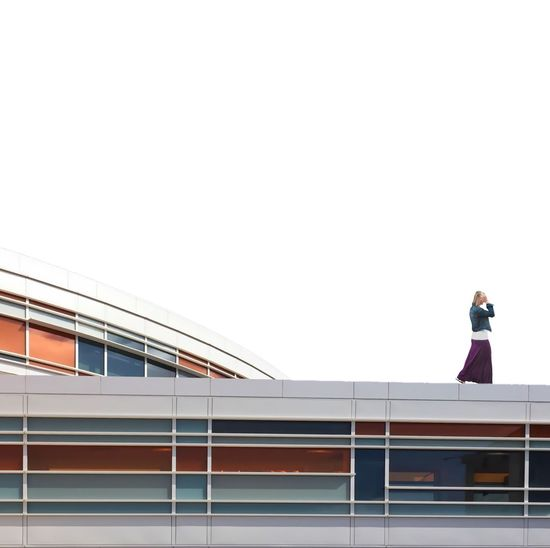 Low angle view of woman standing against built structure