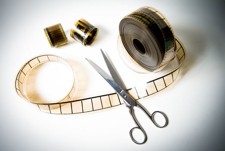35mm Cellulography Cinema Close-up Cut Editing Film Film Industry Filmstrips Final Cut MOVIE No People Post Production Scissors White Background