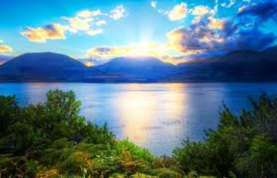 Scenics Tranquil Scene Water Lake Sunset Tranquility Beauty In Nature Idyllic Non-urban Scene Majestic Reflection Sky Mountain Tourism Nature Blue Travel Destinations Cloud - Sky Vacations Calm