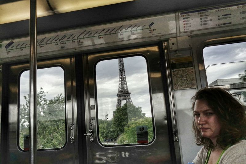 Transportation Mode Of Transportation Rail Transportation Travel Public Transportation Train Window Vehicle Interior Glass - Material Train - Vehicle Real People Portrait One Person Day Architecture Paris Tour Eiffel Eiffel Tower Metro