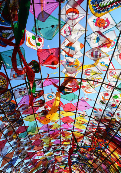 Low angle view of decoration hanging on glass ceiling
