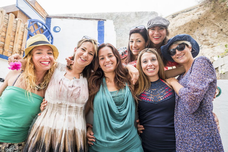 Portrait of cheerful female friends standing outdoors