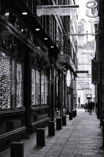 City Architecture Building Exterior Built Structure Pathway The Way Forward vanishing point Long Road Marking Narrow Building Walkway Bollard Archway Empty Road Passageway Historic Wall Lamp