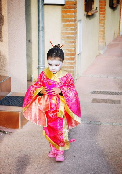 Geisha Girl Walking On Street