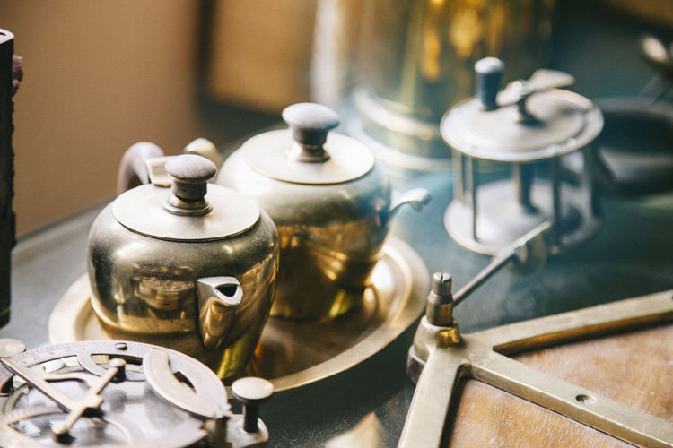 Close-Up Of Tea Kettles In Kitchen