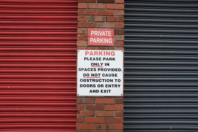 Sign Architecture Building Exterior Built Structure Close-up Communication Corrugated Iron Day Guidance No Parking Sign No People Outdoors Red Road Sign Shutter Street Streetphotography Text