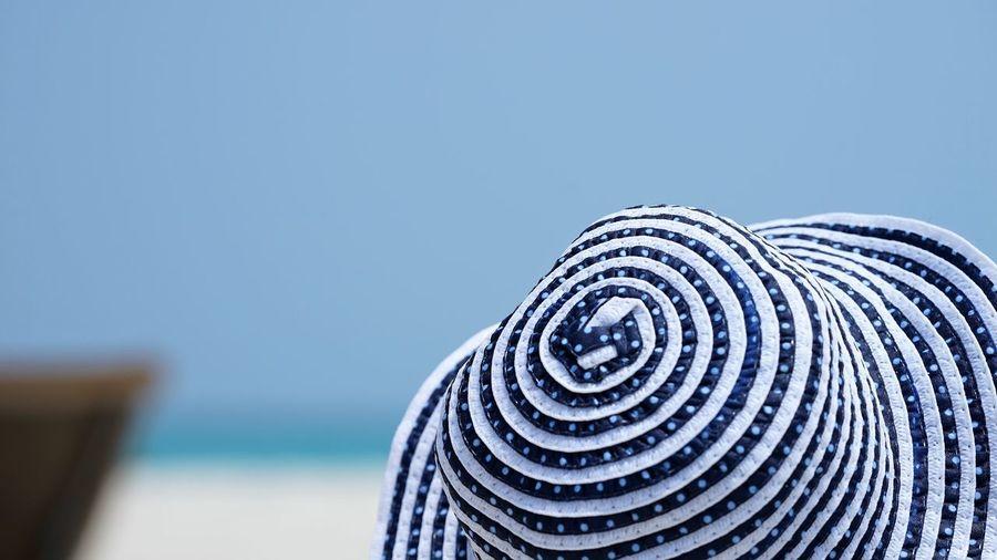 White blue striped hat at beach