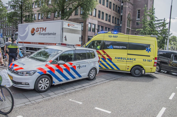 Scooter Accident At The Linnaeusstraat And Eerste Van Swindenstraat Amsterdam The Netherlands 30-5-2018 Amsterdam East Netherlands Policeman Scooter Accident Ambulance Ambulance Service Ambulance Staff Dutch Holland Police Policewoman