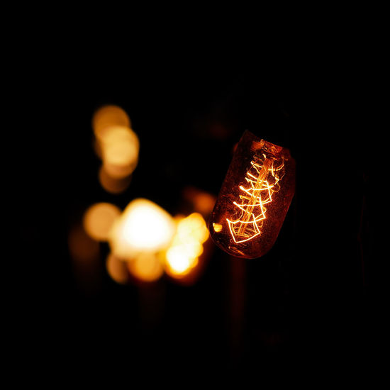 Night Lights Black Background Illuminated Hanging Chinese Lantern Festival Celebration Chinese New Year Lantern Lighting Equipment Arts Culture And Entertainment Close-up Paper Lantern Filament Light Bulb Bulb Pendant Light Lit Electricity  Electric Light Bauble Darkroom Christmas Decoration