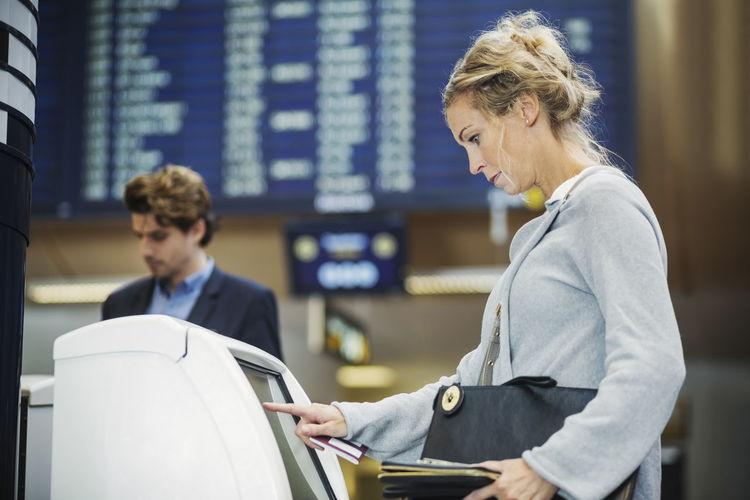 Man looking at camera while standing at airport