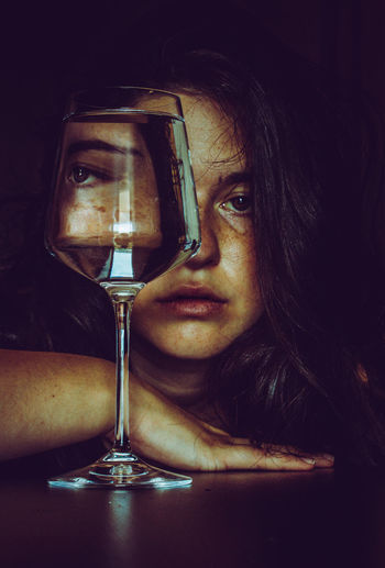 Portrait of woman drinking glasses on table