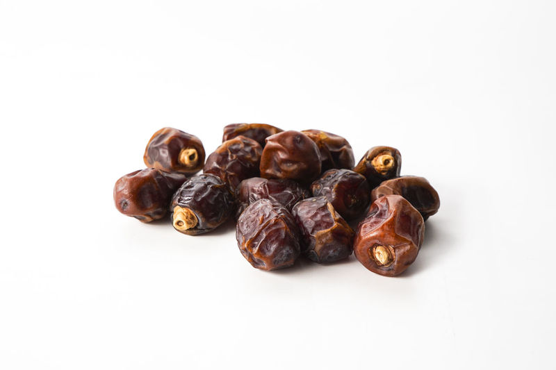 Close-up Dried Fruit Food Food And Drink Freshness Kurma No People Raisin Still Life Studio Shot White Background