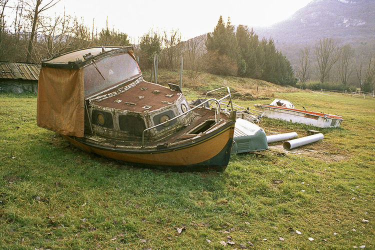 #3 Abandoned Boat Italy Unusual View Tree Water Nautical Vessel Grass Sky