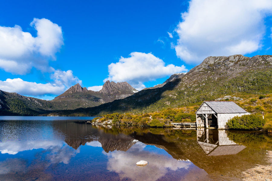 World Heritage Cradle Mountain, Historic Boat Shed and Dove Lake in Cradle Mountain - Lake St Clair National Park, Tasmania Australia Beauty In Nature Blue Boat Shed Cloud - Sky Cradle Mountain Day Dove Lake Idyllic Lake Landscape Mountain Mountain Range Nature Outdoors Reflection Scenics Sky Tasmania Tranquil Scene Tranquility Travel Destinations Vacations Water