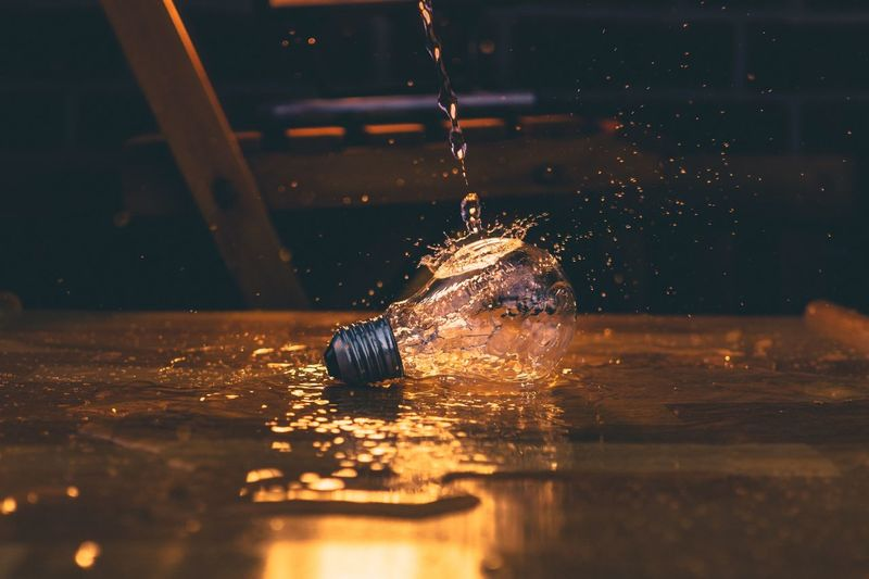 Water falling on light bulb