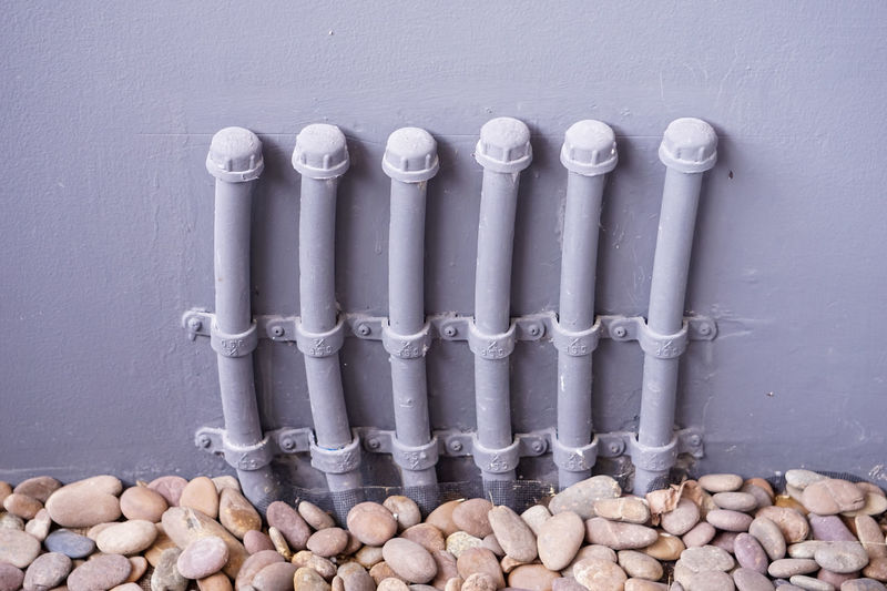 High angle view of pipes on wall