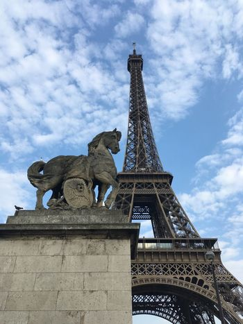 Statue of a horse in front of the Eiffel Tower France Eiffel Tower Paris Architecture Sky Built Structure Cloud - Sky Low Angle View Sculpture History Tower Art And Craft Travel Destinations Animal Representation Statue Building Exterior Tall - High City The Past Day Representation Nature Tourism The Traveler - 2018 EyeEm Awards The Architect - 2018 EyeEm Awards