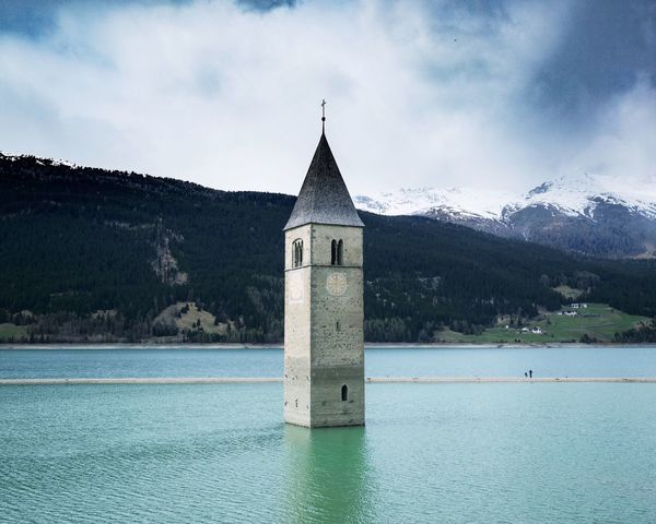 Sky Cloud - Sky Religion Mountain Architecture Built Structure Water Day Outdoors Sea Nature Tranquility Building Exterior Bell Tower Scenics Church Beauty In Nature at Lago Di Resia (Reschensee) Südtirol Neighborhood Map The Architect - 2017 EyeEm Awards The Great Outdoors - 2017 EyeEm Awards