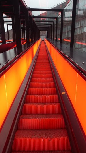 Red escalator Transportation Moving Moving Up Moving Walkway  Moving Forward  Going Up Going Down Yellow Modern Structure Bold Primary Colors Essen Germany Europe Art Art In Life City Red Modern Steps Architecture Built Structure Travel Subway Steps And Staircases Escalator Hand Rail Stairway Staircase Stairs