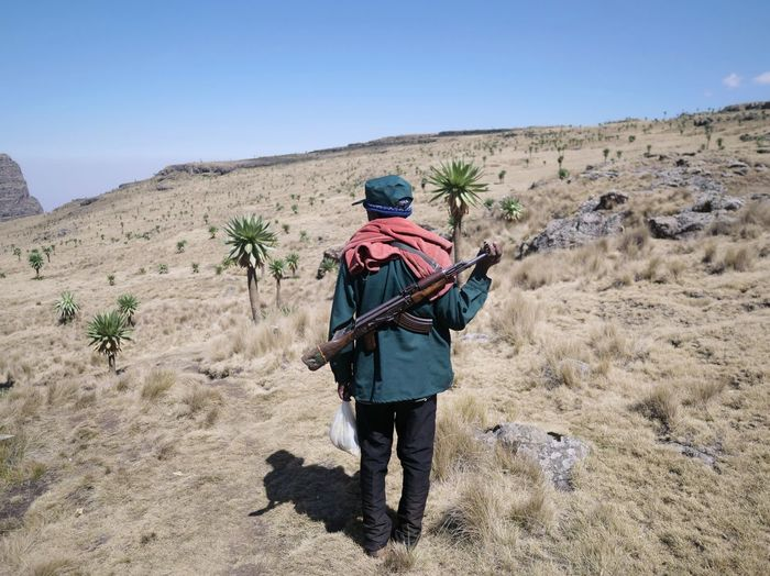 Simien Mountains Scout Guard AK47 Simien Mountains National Park Ethiopia Africa Men Arid Climate Rear View Sky Countryside Hiking The Photojournalist - 2019 EyeEm Awards The Great Outdoors - 2019 EyeEm Awards The Traveler - 2019 EyeEm Awards