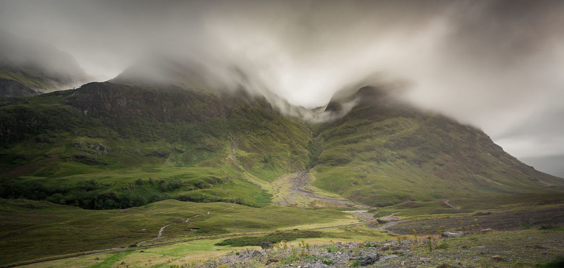 Mountains in Glencoe valley, Scotland Glencoe Scotland Landscape Mountain Fog Clouds Cloudscape Green Grass Vacations Travel Destinations Tranquility Peace Quiet Moments Calm Scenics - Nature Environment Tranquil Scene Power In Nature Mountain Range