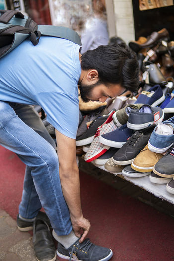 Man trying shoes in market