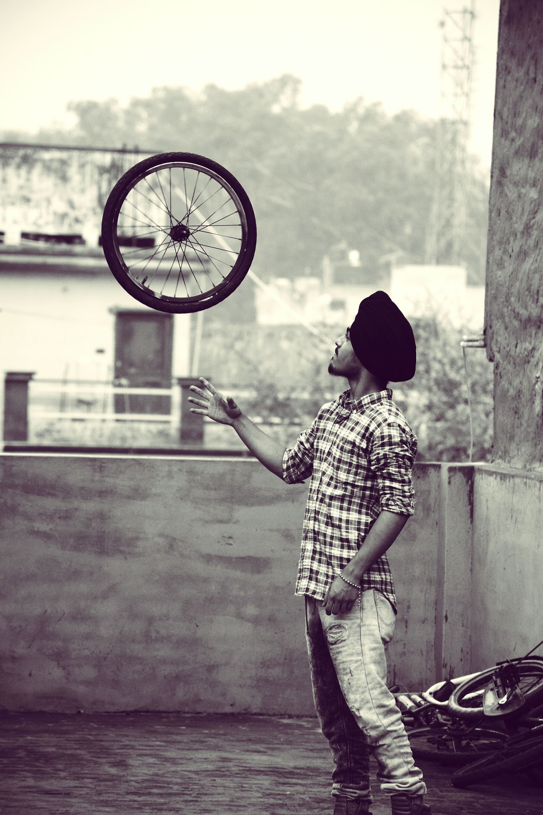 bicycle, transportation, mode of transport, street, land vehicle, leisure activity, full length, lifestyles, side view, men, outdoors, day, water, holding, cycling, built structure, riding, road