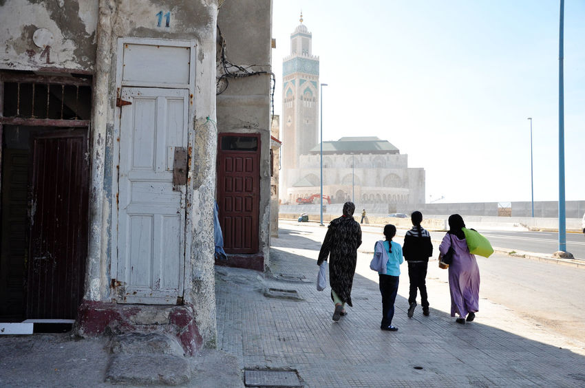 Arab Arabic Architecture Building Exterior Built Structure Contrast Family Islam Islamic Architecture Kids Marrakech Moroco Mosque People Poor  Real People Rear View Walking Miles Away Women Around The World