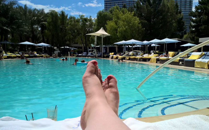 Poolside Adult Barefoot Day Human Body Part Human Leg Leisure Activity Lifestyles Live For The Story Low Section Nature One Person Outdoors People Poolside Real People Relaxation Summer Sunlight Swimming Swimming Pool Tree Vacations Water