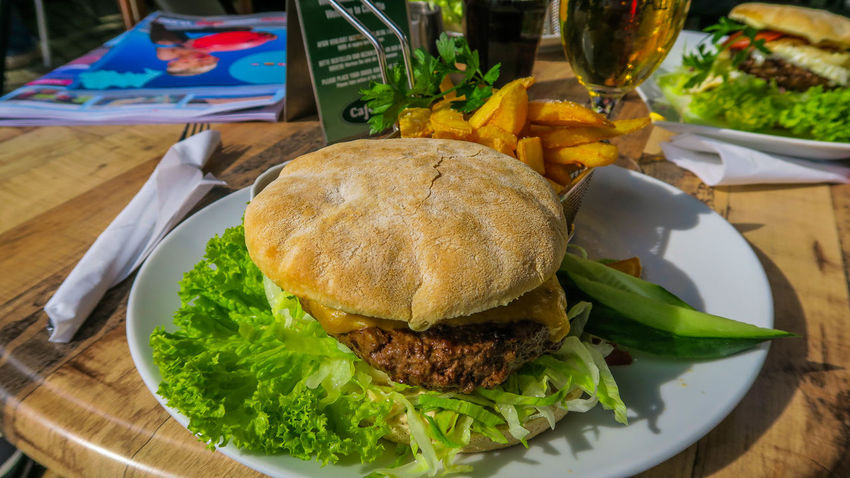 Blåvand Denmark Bun Burger Burgers Close-up Colorful Day Fast Food Food Food And Drink Fork Freshness Hamburger Indoors  Indulgence Lettuce No People Plate Ready-to-eat Salad Serving Size Table Unhealthy Eating Vegetable