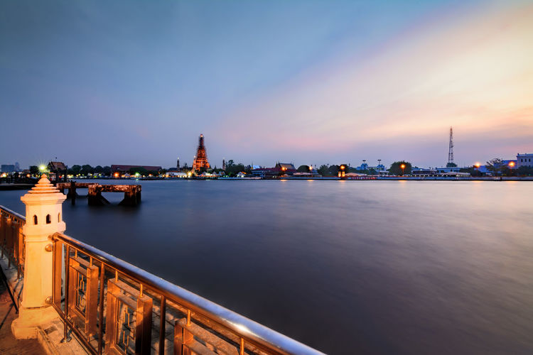 Scenic view of chao phraya river against sky during sunset