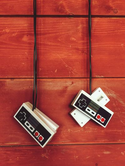 Retrogaming Wireless Technology Wood - Material Indoors  Wood Paneling Technology Close-up Nintendo Console Tied Hanging Gaming Gaming Time Controller Remote Remember Lifestyles EyeEmBestPics Exceptional Photographs Bestoftheday Eye4photography