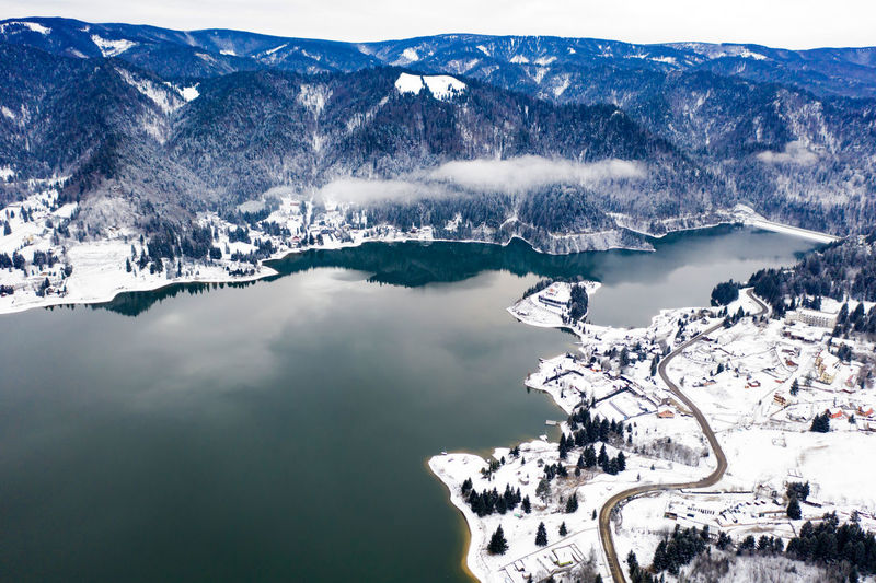 Aerial view of lake by snow covered town