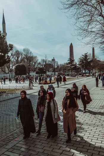 Group of people on street in city