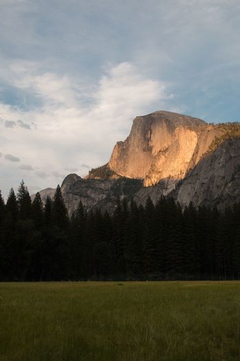 Half Dome Mountain Scenics Tranquil Scene Beauty In Nature Grass Tranquility Mountain Range Sky Tree Landscape Nature Mountain Peak Cloud - Sky Non-urban Scene Grassy Growth Green Color Majestic Physical Geography Geology