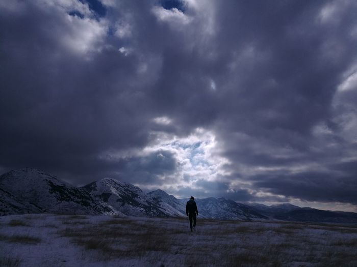 Stay in the light Leicacamera Huaweiphotography HuaweiP9 Storm Cloud - Sky Storm Cloud Mountain Landscape Silhouette Thunderstorm Outdoors Night Snow Travel Destinations One Person Full Length People Only Men Nature Beauty In Nature One Man Only Sky Adult