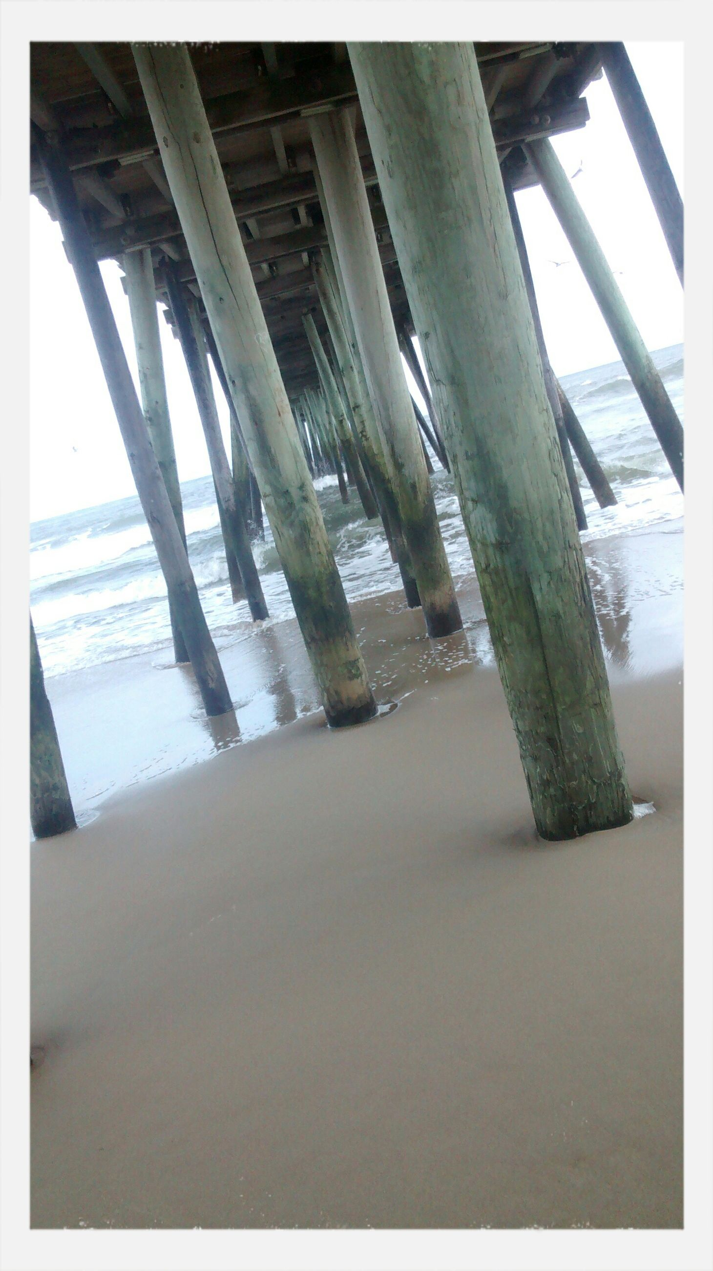 sea, transfer print, water, horizon over water, built structure, indoors, auto post production filter, sunlight, beach, architecture, shadow, sand, day, sky, architectural column, no people, pier, nature, shore, column