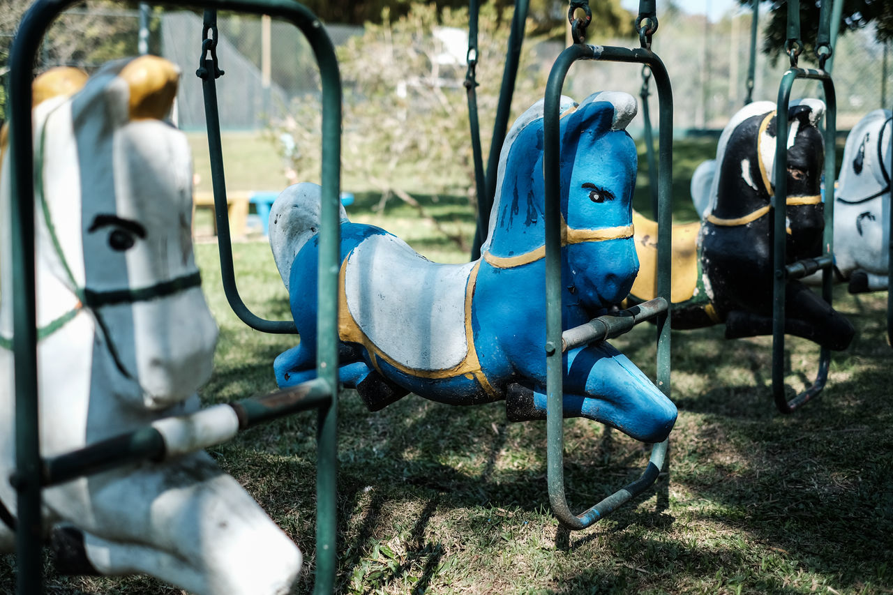 playground, outdoor play equipment, childhood, blue, no people, park - man made space, hanging, day, swing, outdoors, carousel, merry-go-round, nature