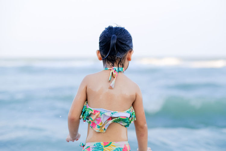 Rear view of woman on beach