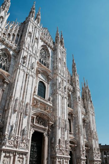 Low Angle View Of Milan Cathedral Against Clear Sky In City